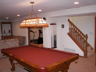 Basement man cave with pool table and gym