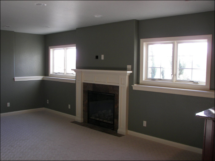 Custom fireplace construction with egress windows