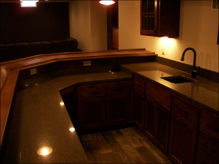 Muksego custom-built wet bar with mini fridge & sink