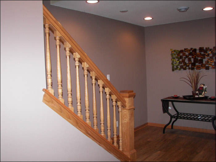 Basement staircase with maple wood