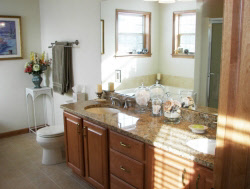 Oconomowoc Bathroom Remodel With Quartz Counters And Wide Mirror