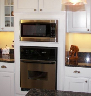 Tall cabinet with oven and microwave cut-out
