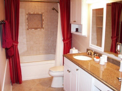 Wisconsin bathroom renovation with new flooring & mirrors