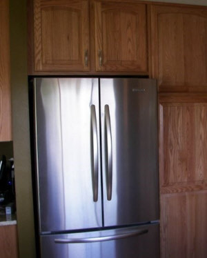 Wall cabinet with refrigerator cut-out