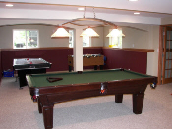 Man cave with pool table, foosball and ice hockey